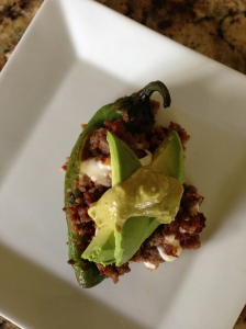 Stuffed pepper, with avocado and green sauce